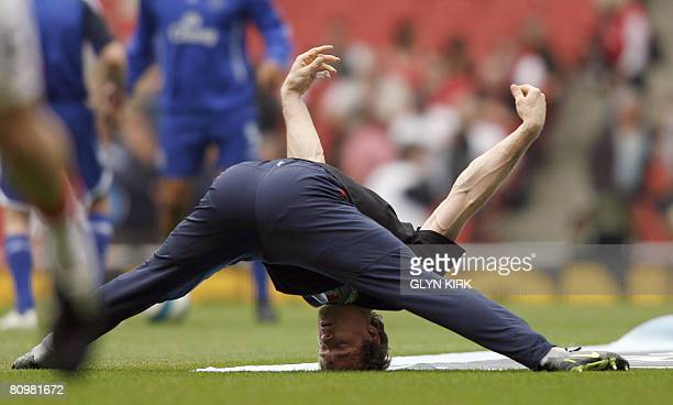 Arsenal's German Goalkeeper Jens Lehmann warms up before their Premier League match against Everton at the Emirates Stadium North London England on...