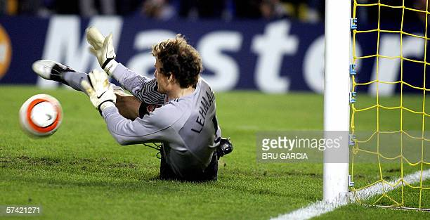 Arsenal's German goalkeper Jens Lehmann saves a penalty during their Champions League semi-final second leg football match at the Madrigal stadium in...