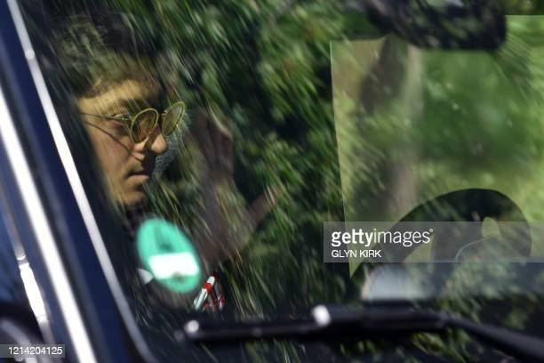 Arsenal's German midfielder Mesut Ozil arrives at Arsenal's Colney training centre north of London on May 20 2020 as training continues for Premier...