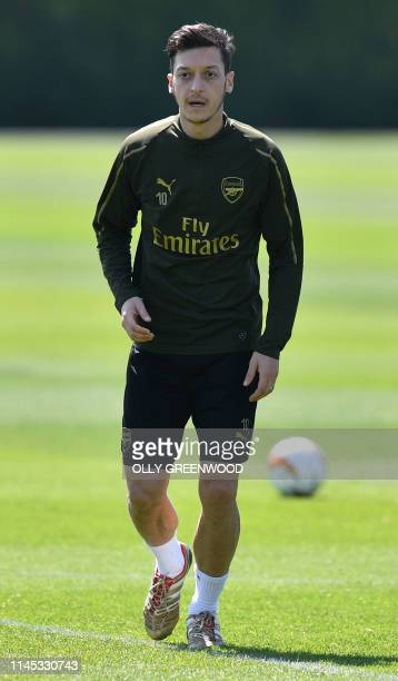 Arsenal's German midfielder Mesut Ozil attends a training session at Arsenal's London Colney training centre in St. Albans on May 21, 2019 ahead of...