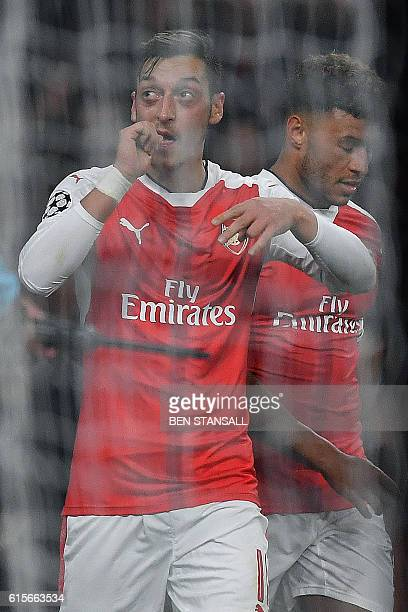 Arsenal's German midfielder Mesut Ozil celebrates scoring his team's fifth goal during the UEFA Champions League Group A football match between...
