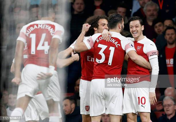 Arsenal's German midfielder Mesut Ozil celebrates scoring the opening goal during the English Premier League football match between Arsenal and...