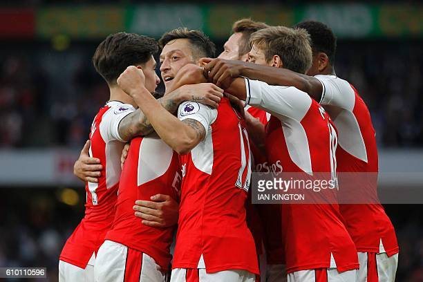 Arsenal's German midfielder Mesut Ozil celebrates scoring their third goal during the English Premier League football match between Arsenal and...