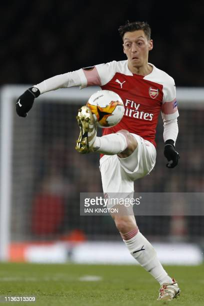 Arsenal's German midfielder Mesut Ozil controls the ball during the UEFA Europa League quarter final first leg football match between Arsenal and...