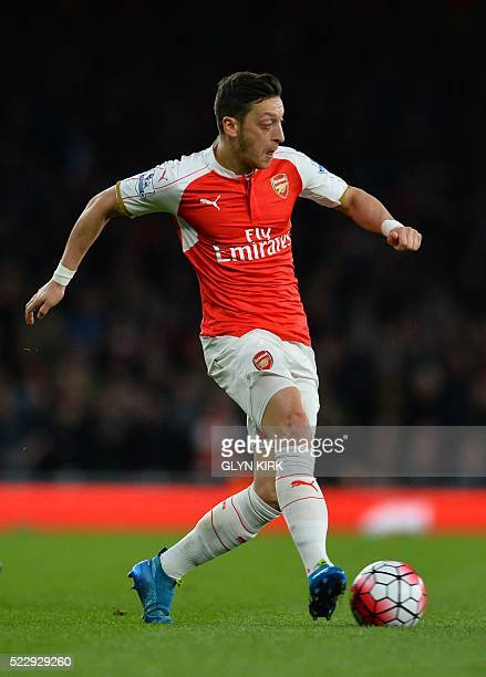 Arsenal's German midfielder Mesut Ozil plays the ball during the English Premier League football match between Arsenal and West Bromwich Albion at...