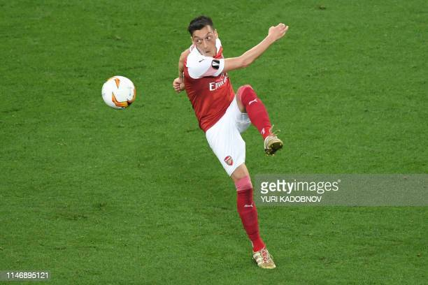Arsenal's German midfielder Mesut Ozil plays the ball during the UEFA Europa League final football match between Chelsea FC and Arsenal FC at the...