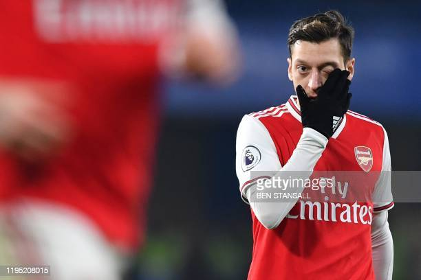 Arsenal's German midfielder Mesut Ozil reacts during the English Premier League football match between Chelsea and Arsenal at Stamford Bridge in...