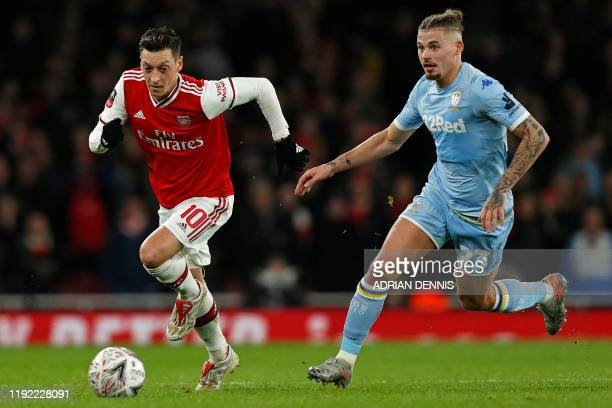 Arsenal's German midfielder Mesut Ozil runs away from Leeds United's English midfielder Kalvin Phillips during the English FA Cup third round...