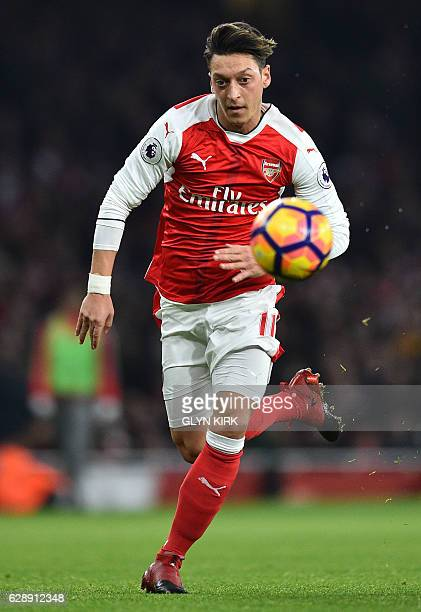 Arsenal's German midfielder Mesut Ozil runs for the ball during the English Premier League football match between Arsenal and Stoke City at the...