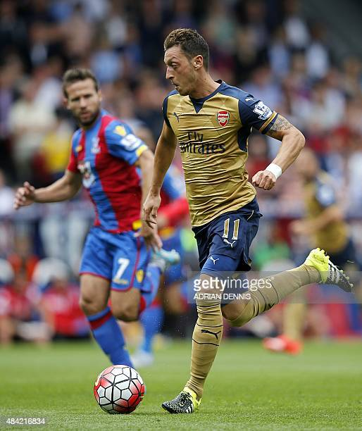 Arsenal's German midfielder Mesut Ozil runs with the ball during the English Premier League football match between Crystal Palace and Arsenal at...