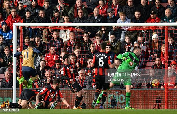 Arsenal's German midfielder Mesut Ozil scores his team's first goal during the English Premier League football match between Bournemouth and Arsenal...