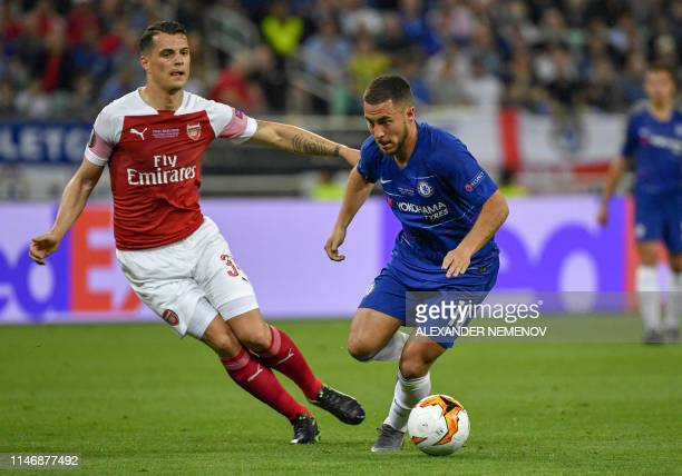Arsenal's Germanborn Bosnian defender Sead Kolasinac and Chelsea's Belgian midfielder Eden Hazard vie for the ball during the UEFA Europa League...