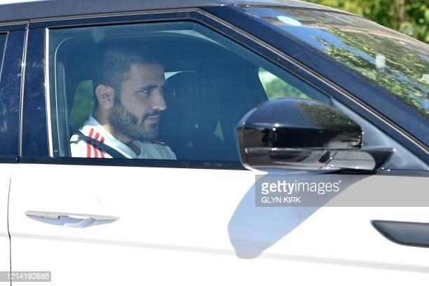 Arsenal's Germanborn Bosnian defender Sead Kolasinac arrives at at Arsenal's Colney training centre north of London on May 20 2020 as training...