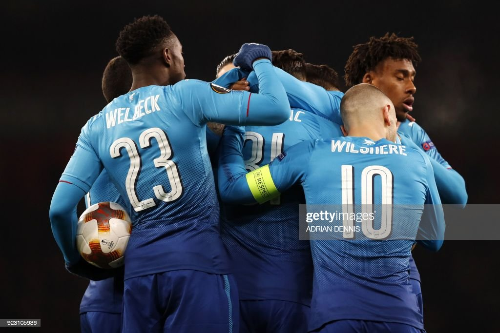 TOPSHOT - Arsenal's German-born Bosnian defender Sead Kolasinac (C) celebrates with teammates after scoring their first goal during the second leg of the Europa League Round of 32 football match between Arsenal and Ostersunds at the Emirates Stadium in London on February 22, 2018. / AFP PHOTO / Adrian DENNIS / RESTRICTED TO EDITORIAL USE. No use with unauthorized audio, video, data, fixture lists, club/league logos or 'live' services. Online in-match use limited to 75 images, no video emulation. No use in betting, games or single club/league/player publications. /