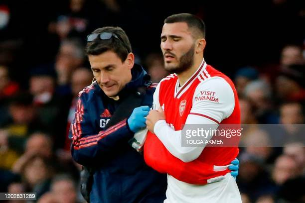 Arsenal's Germanborn Bosnian defender Sead Kolasinac goes off with an injury during the English Premier League football match between Arsenal and...
