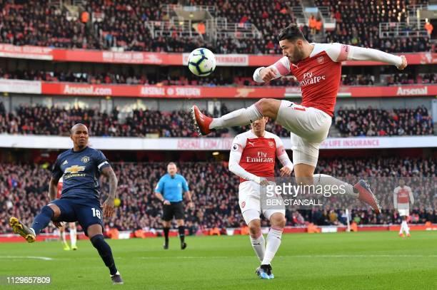 TOPSHOT Arsenal's Germanborn Bosnian defender Sead Kolasinac plays the ball during the English Premier League football match between Arsenal and...