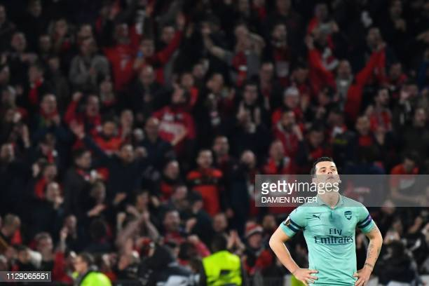 TOPSHOT Arsenal's Germanborn Bosnian defender Sead Kolasinac reacts during the UEFA Europa League round of 16 first leg football match between Stade...