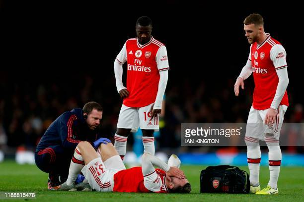 Arsenal's Germanborn Bosnian defender Sead Kolasinac receives treatment for an injury during the English Premier League football match between...