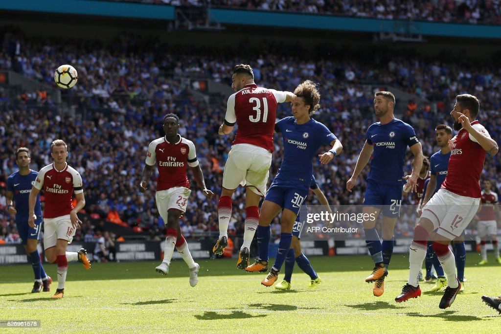 Arsenal's German-born Bosnian defender Sead Kolasinac (C) scores the team's first goal during the English FA Community Shield football match between Arsenal and Chelsea at Wembley Stadium in north London on August 6, 2017. / AFP PHOTO / Ian KINGTON / NOT