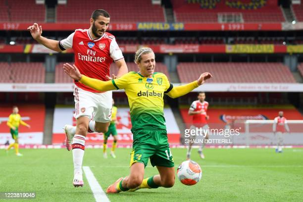 Arsenal's Germanborn Bosnian defender Sead Kolasinac tackles Norwich City's English midfielder Todd Cantwell during the English Premier League...