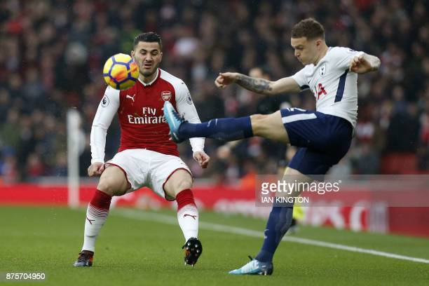Arsenal's Germanborn Bosnian defender Sead Kolasinac vies with England's defender Kieran Trippier during the English Premier League football match...