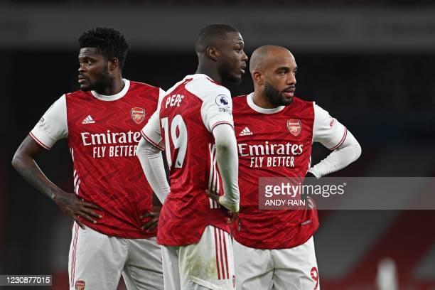 Arsenal's Ghanaian midfielder Thomas Partey , Arsenal's French-born Ivorian midfielder Nicolas Pepe and Arsenal's French striker Alexandre Lacazette...