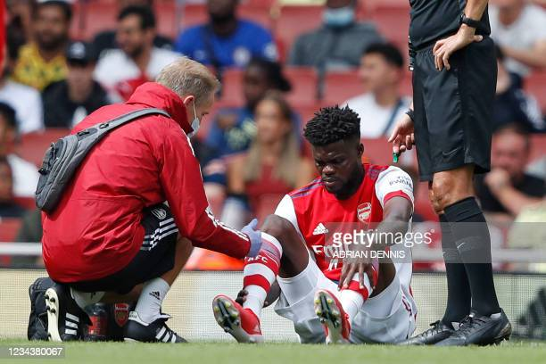 Arsenal's Ghanaian midfielder Thomas Partey receives treatment for an injury during the pre-season friendly football match between Arsenal and...