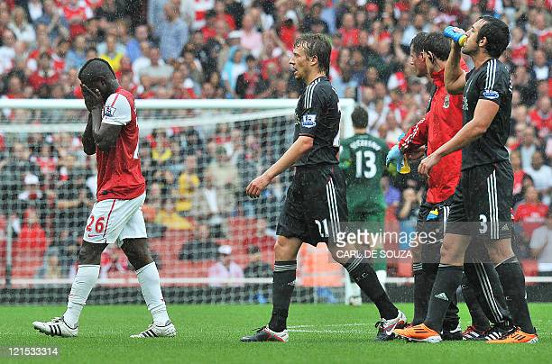 Arsenal's Ghanaian/English midfielder Emmanuel Frimpong walks off the pitch after receiving a red card during the English Premier League football...