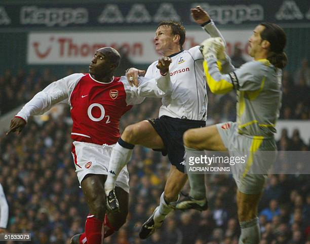Arsenal's goalkeeper David Seaman and Sol Campbell sandwich Teddy Sheringham of Tottenham Hotspur during the Premiership match at White Hart Lane in...