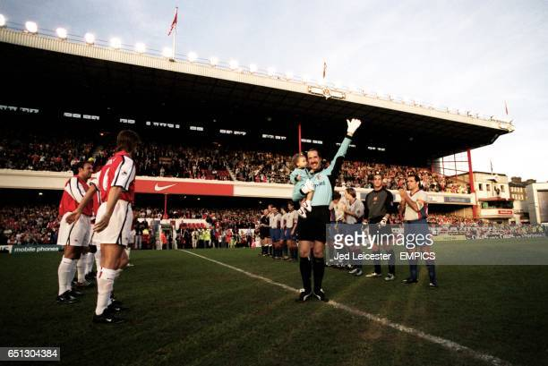 Arsenal's goalkeeper David Seaman waves to the Highbury crowd whist holding his baby daughter Georgina as the respective teams of Arsenal and...