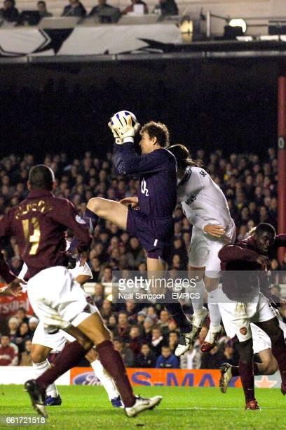 Arsenal's goalkeeper Jens Lehmann claims the ball under pressure