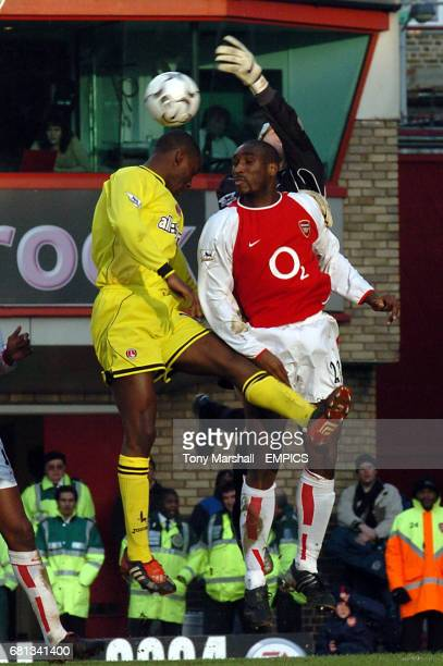 Arsenal's goalkeeper Jens Lehmann gets a hand to the ball ahead of Charlton Athletic's Carlton Cole