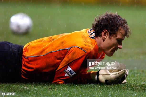 Arsenal's Goalkeeper Jens Lehmann looks dejected after conceding a late equaliser scored by Bolton Wanderers' Henrik Pedersen