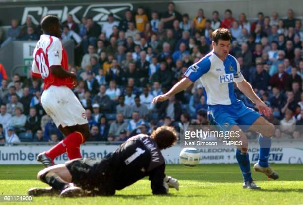 Arsenal's goalkeeper Jens Lehmann saves at the feet of Blackburn Rovers' Ryan Nelsen