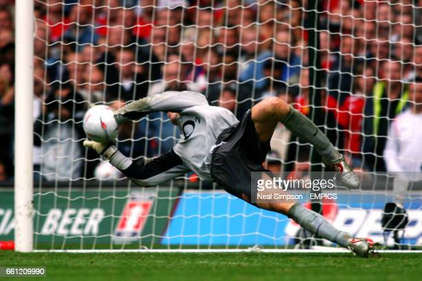 Arsenal's goalkeeper Jens Lehmann saves in the penalty shoot out from Manchester United's Paul Scholes