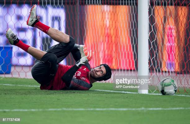 Arsenal's goalkeeper Petr Cech reacts during a training session ahead of the International Champions Cup football match between Bayern Munich and...