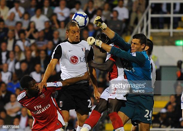 Arsenal's goalkeeper Vito Mannone punches the ball clear past Fulham's Bobby Zamora