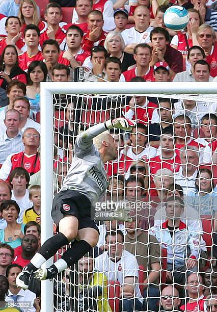 Arsenal's goalkeper Manuel Almunia turns the ball over the bar during the Emirates Cup match against Paris Saint-Germain at Arsenal FC's Emirates...