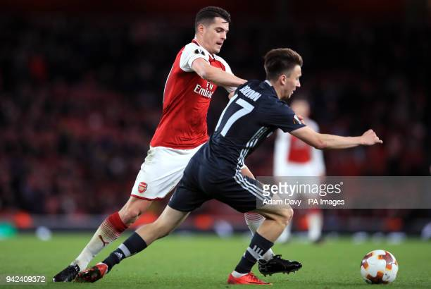 Arsenal's Granit Xhaka and CSKA Moscow's Alexandr Golovin battle for the ball during the UEFA Europa League quarter final first leg match at the...