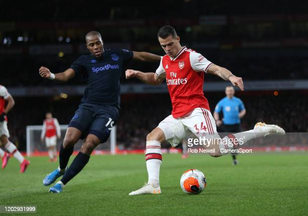 Arsenal's Granit Xhaka and Everton's Djibril Sidibe during the Premier League match between Arsenal FC and Everton FC at Emirates Stadium on February...