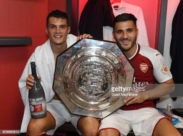Arsenal's Granit Xhaka and Sead Kolasinac with the Community shield in the changing room after the FA Community Shield match between Chelsea and...