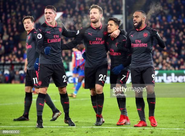 LR Arsenal's Granit Xhaka Arsenal's Shkodran Mustafi Arsenal's Alexis Sanchez and Arsenal's Alexandre Lacazette celebrates Arsenal's Alexis Sanchez...