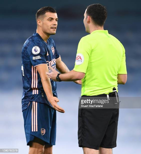 Arsenal's Granit Xhaka talks to the referee during the Premier League match between Manchester City and Arsenal at Etihad Stadium on October 17 2020...