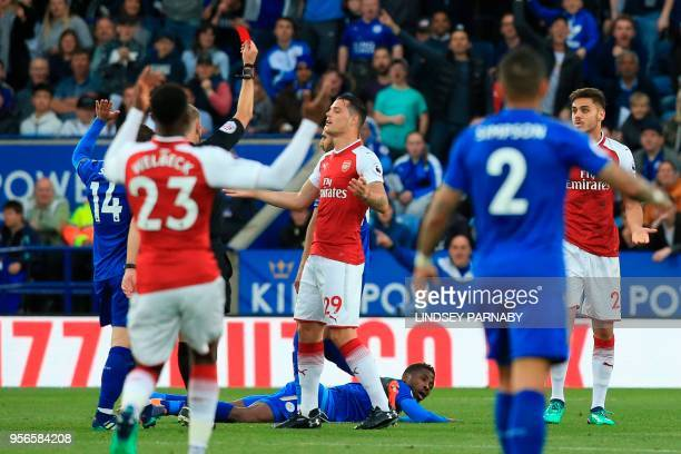 Arsenal's Greek defender Konstantinos Mavropanos is shown a red card by referee Graham Scott for a foul on Leicester City's Malian midfielder...