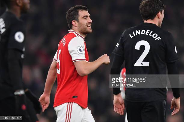 Arsenal's Greek defender Sokratis Papastathopoulos celebrates after scoring their second goal during the English Premier League football match...