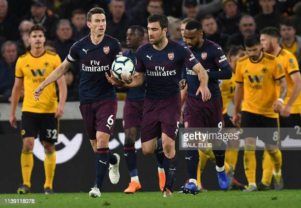 Arsenal's Greek defender Sokratis Papastathopoulos celebrates scoring his team's first goal during the English Premier League football match between...