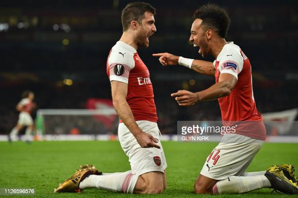 Arsenal's Greek defender Sokratis Papastathopoulos celebrates with Arsenal's Gabonese striker PierreEmerick Aubameyang after scoring their third goal...