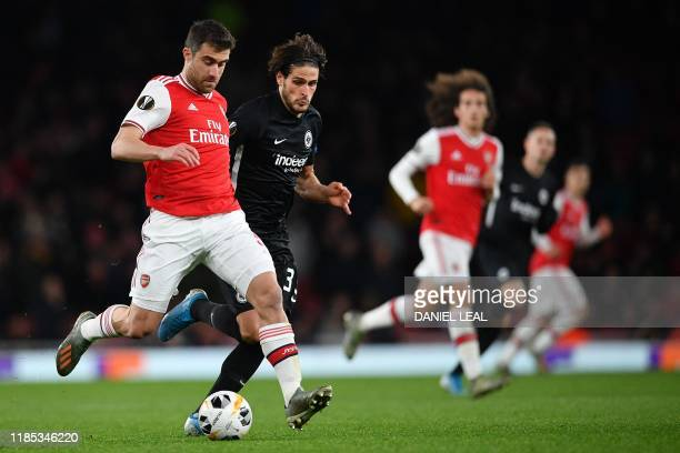 Arsenal's Greek defender Sokratis Papastathopoulos controls the ball during their UEFA Europa league Group F football match between Arsenal and...