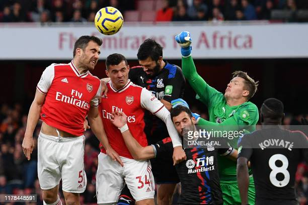 Arsenal's Greek defender Sokratis Papastathopoulos jumps to win a header in the Palace area during the English Premier League football match between...