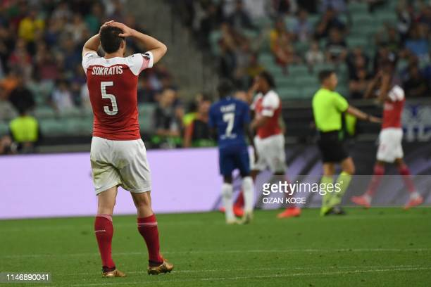 Arsenal's Greek defender Sokratis Papastathopoulos reacts during the UEFA Europa League final football match between Chelsea FC and Arsenal FC at the...